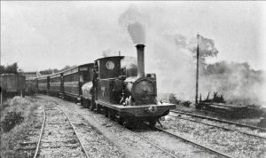 Four Carriage Train climbing gradient out of Halesworth Narrow Gauge Station